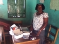 Ms Koroma with laptop and stationery donated by Dobbs on her second visit