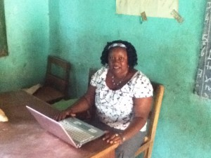 Ms Koroma (Deputy Head) with laptop donated by Dobbs